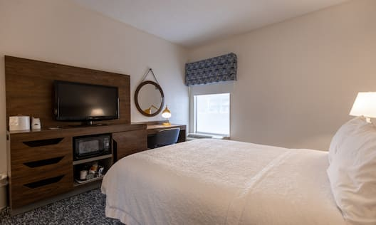 Accessible Queen Bed and TV