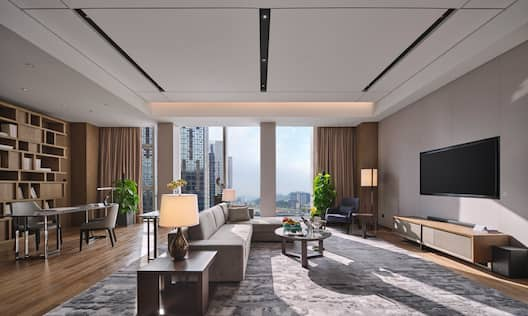 Lounge area with seating and TV