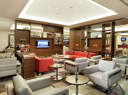 Lobby Seating Area with Sofas and Television