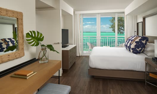 Premium Suite Bedroom with Large Bed and Water View