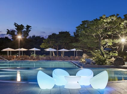 Outdoor Pool Area at Night