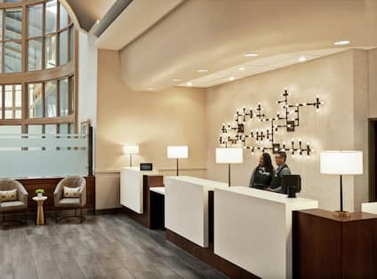 Lobby and Front Desk with Staff Members