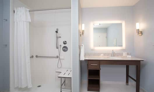 Accessible Guest Bathroom with Vanity and Roll-In Shower