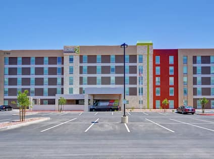 Hotel Exterior Building and Parking Lot in Daytime