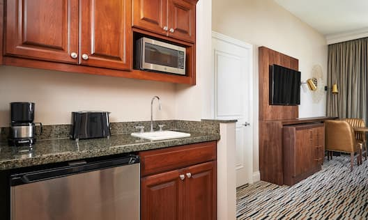 Kitchenette with TV in background