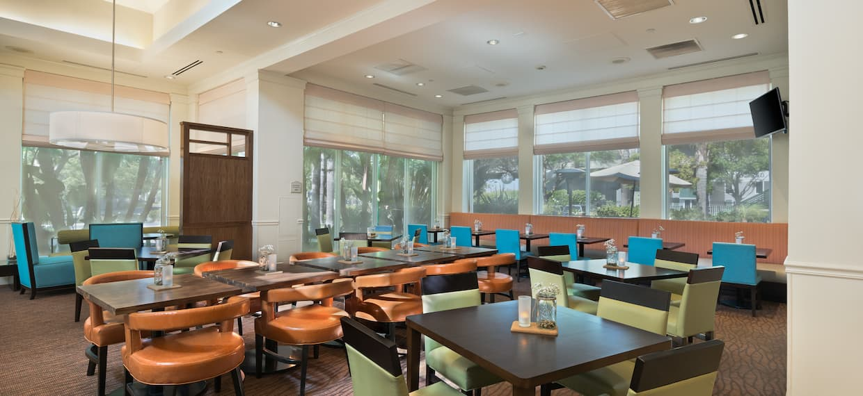 Table and Booth Seating in Restaurant Dining area With Outside Views