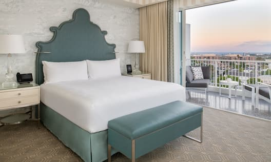 Bed in room with balcony