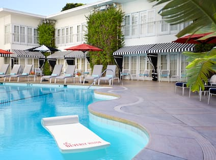 Outdoor Pool with Lounge Chairs and Umbrellas