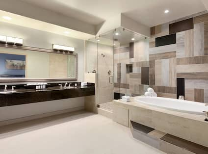Presidential Suite Bathroom with Tub and Shower