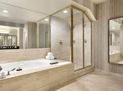 Upper Penthouse Bathroom with Tub and Shower