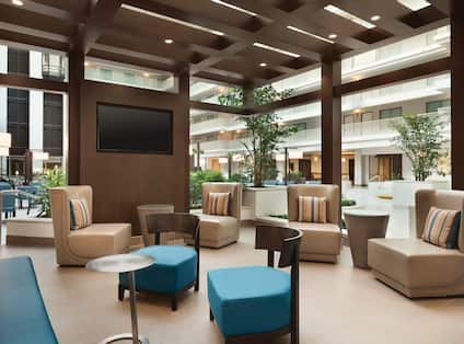 Lobby Atrium Seating Area with Chairs and Wall Mounted HDTV