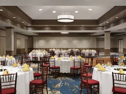 Spacious Ballroom with Round Tables and Chairs