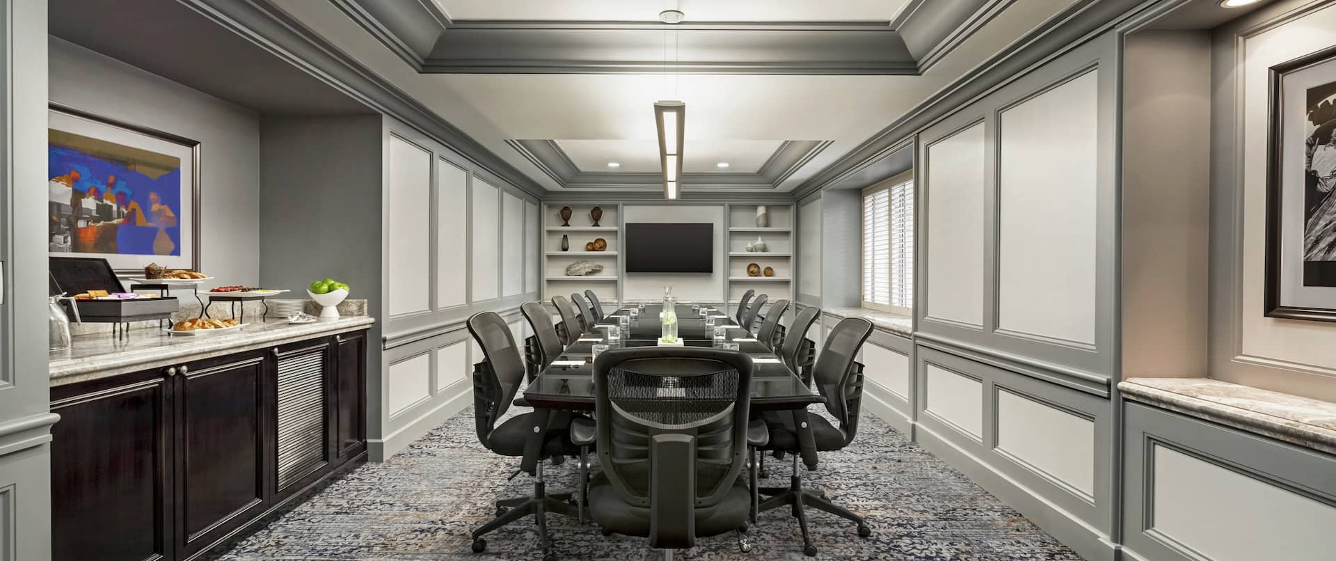 Hilton Boardroom with Table, Chairs, and HDTV