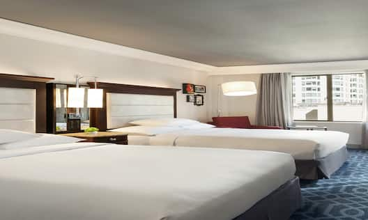 Two Doubles Corner Guestroom with Two Beds, Lounge Area, and Room Technology