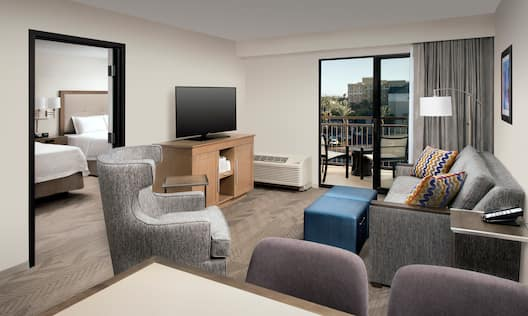 Suite Living Room with Views of the Patio and Bedroom