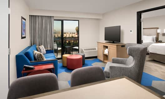 Double Queen Suite Living Room with Patio View and an HDTV