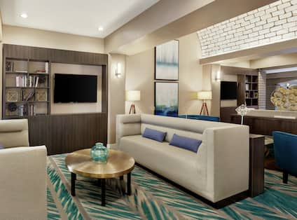 Embassy Suites Lobby and Lounge Area with TV