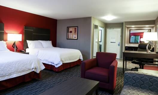 Studio Suite with Two Queen Beds, Lounge Area, Work Desk, and Wetbar