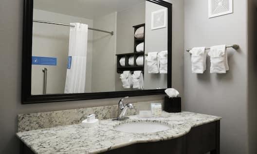 Suite Bathroom with Mirror, Vanity, Shower, and Bathtub