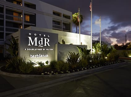 Hotel Exterior at Night with Sign