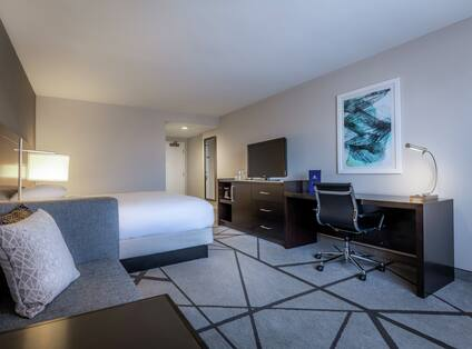 Executive King Room bed, sofa, work desk and TV