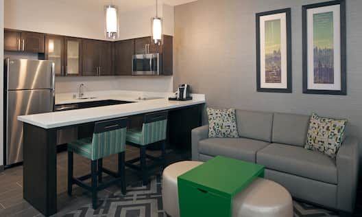 Guestroom Kitchen Suite Fridge Counter Sofa and Footrest