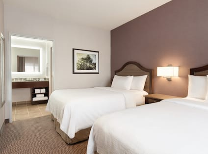 Double Bed Guestroom Suite and View to Bathroom