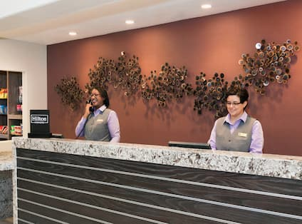 Front Desk with Two Staff Members