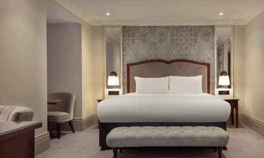 a guest bedroom with a king bed