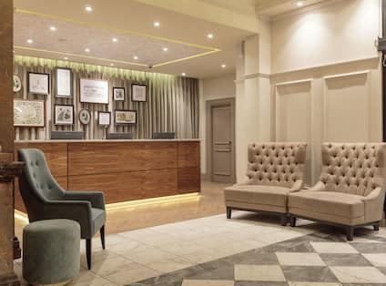 a front desk and lobby seating area