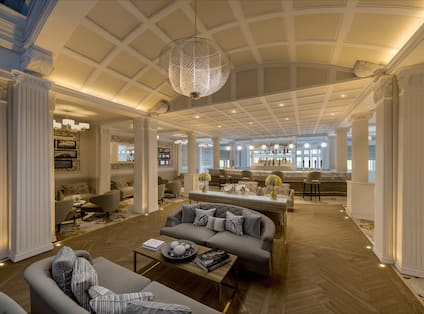 Lounge Area with Couches, Chairs, and Tables