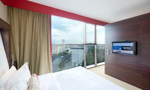 King Bed, Wall-Mounted TV and View from Large Windows