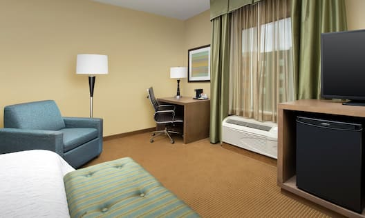 Guest Room with King Bed, Work Desk, and HDTV