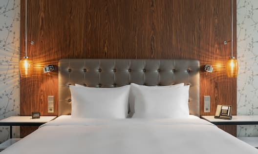 One King Bed Guestroom with View of Headboard and Pillows