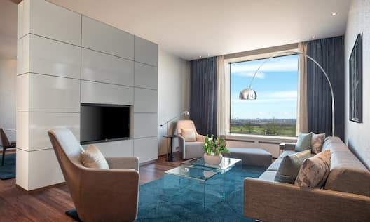 Presidential Suite Lounge Area with Sofa, Armchairs and Wall Mounted HDTV