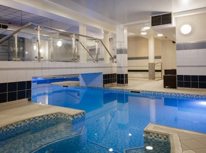 Indoor Pool with Walkway Bridge