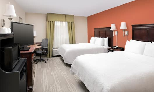 Guestroom with Two Queen Beds, Work Desk, Television, Microwave and Fridge