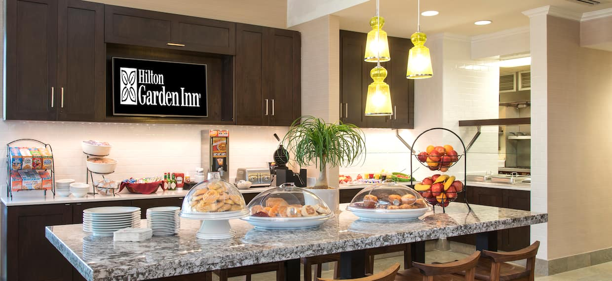 TV and Buffet Selection of Hot and Cold Buffet Items in Breakfast Area of Garden Grille & Bar
