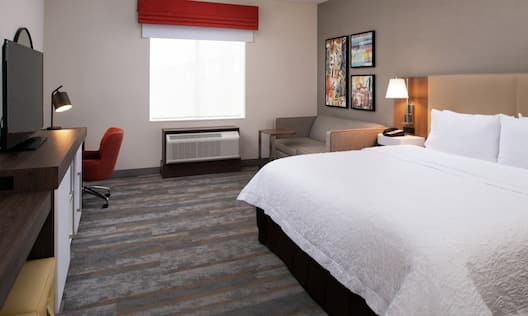 Accessible Guestroom with Large Bed Sofa Desk and HDTV