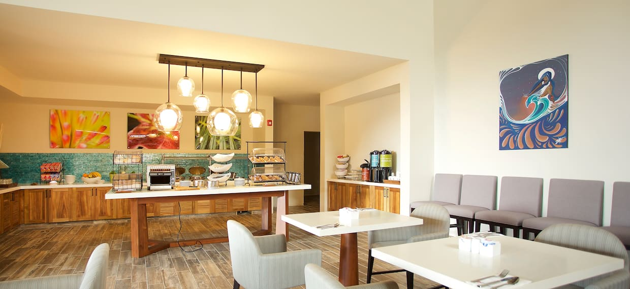 Dining Tables and Buffet Items in Breakfast Area With Wall Art