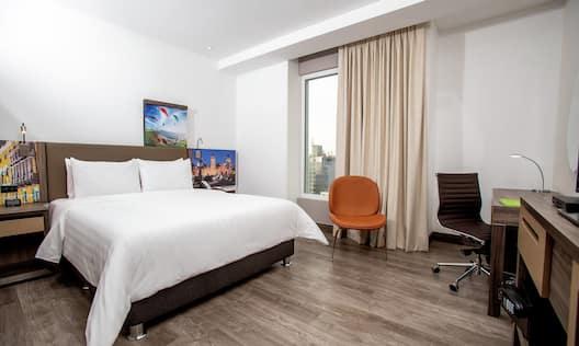 One Queen Bed Guest Bedroom with Work Desk