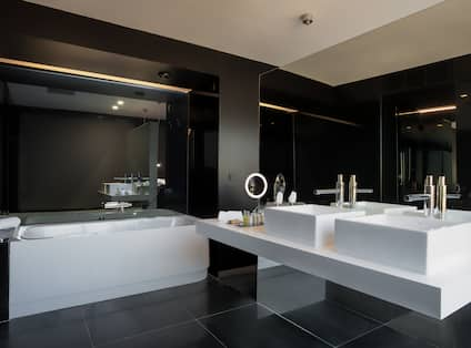 Bathroom with Dual Vanity and a Bathtub