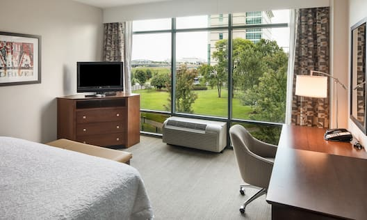 King Bed with Bench, TV and Work Desk with Large Windows