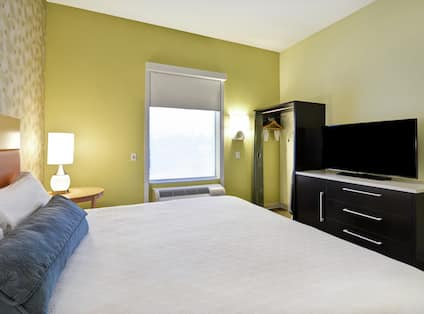 Suite Bedroom with King Bed and TV