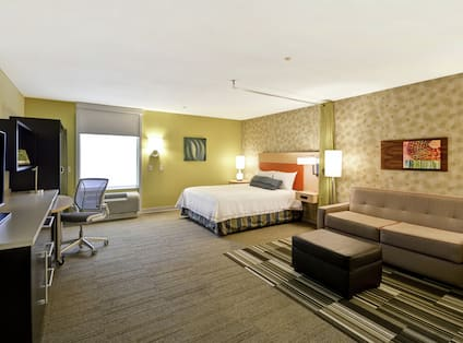 Studio Suite with Queen Bed, Work Desk, Lounge Area, and TV