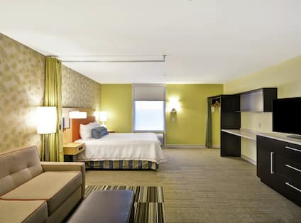 Studio Suite with Queen Bed, Lounge Area, and TV