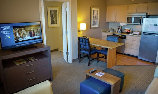 Premium Suite Living Room With Kitchenette, Flat Screen Television, and Table/Work Desk