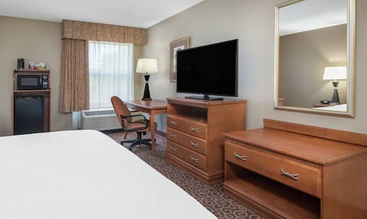 Guest Room with Bed, Work Desk, Kitchenette, and HDTV