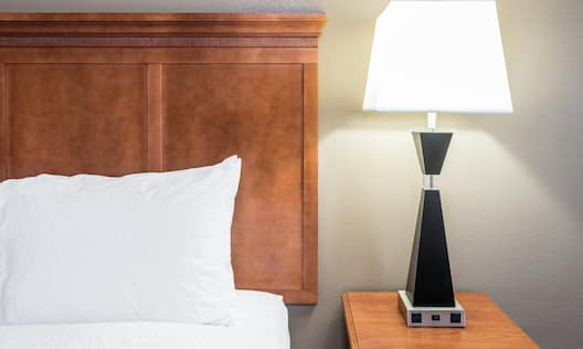 Nightstand with Lamp in Guest Room
