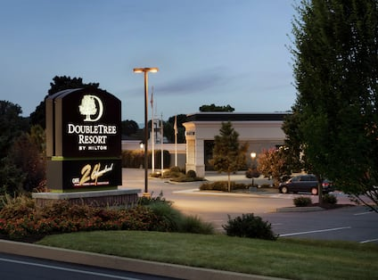 View of DoubleTree Hotel Exterior with Sign at Night